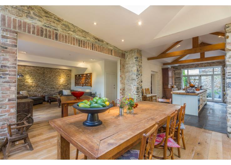 A stylish open plan kitchen and dining area, we love the exposed brickwork.