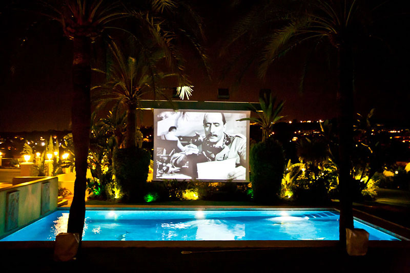 The outdoor cinema screen at this villa in Marbella