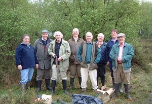 A group of friends and family enjoying a shooting activity during their weekend at Berry House