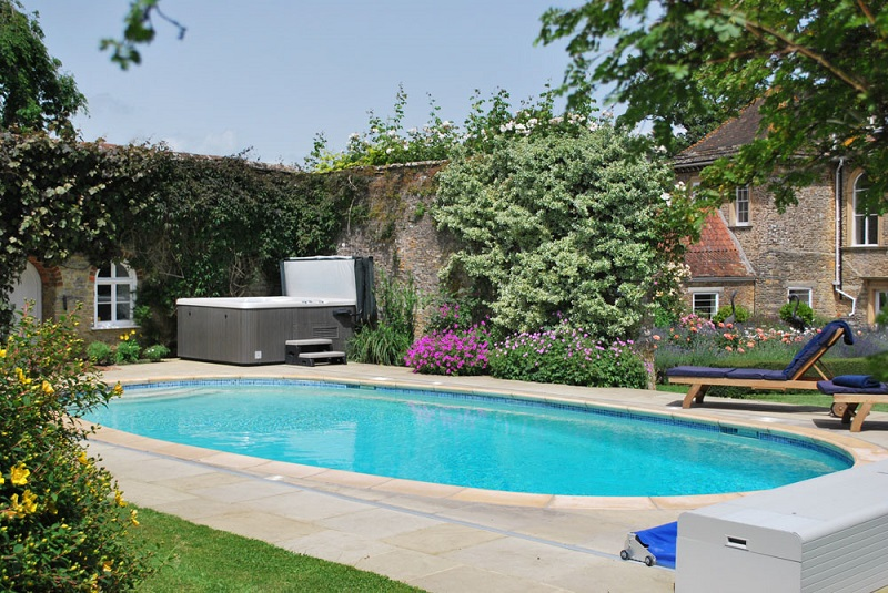 Outdoor pools and hot tubs for guests to enjoy for their summer holidays.
