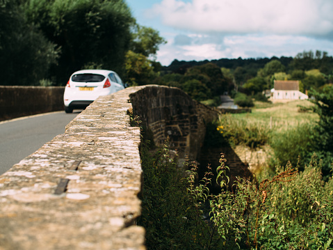 Car travelling over a Bridge in Cotswolds, England