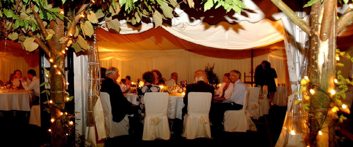marquee pergola and chair covers at night