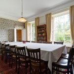 The breakfast room at Tone Dale House has original William Morris wallpaper and elegant sash windows overlooking the lawns