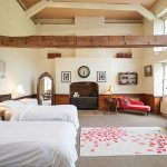 The Laundry bedroom at Tone Dale House is a double storey height stunning bedroom with en-suite bathroom