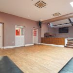A party house with a party room, at Tone Dale House. There's integrated sound and lighting and a wide screen TV.