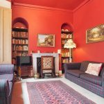 The red sitting room at Tone Dale House, Wellington, Somerset is available to hire through The Big House Company