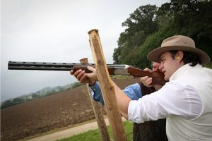 Guests staying at Tone Dale House practicing shooting at a range in Somerset