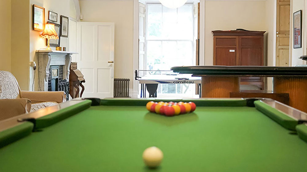 The pool table in the large games room at Tone Dale House