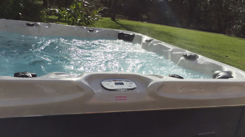 The large hot tub at Tone Dale House is a perfect place to relax with friends in the garden.