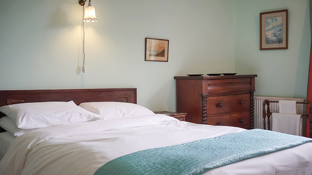This bedroom at Tone Dale House, Somerset has a large double bed and views of the garden.