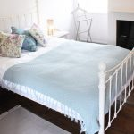 Bedroom 4 has a charming wrought iron bedstead with soft pastel linen
