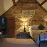 This bedroom at Cotswold Manor has a secret passageway
