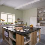 The kitchen at Berry House has a large central island, a farmhouse style dresser and plenty of equipment for a large party