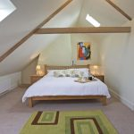 There are 3 bedrooms on the second floor, stylishly decorated with exposed beams