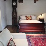 One of the large barn bedrooms with it's own sitting area at Devon Farmhouse in south Devon