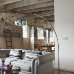 Character filled and spacious sitting and dining area in the courtyard setting of Devon Farmhouse barns.