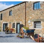 Devon Farmhouse has a charming courtyard area for the barn bedrooms, to give extra accommodation for groups larger than 16
