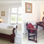 This light filled bedroom at Devon Farmhouse has a charming roll top bed and beautiful antique furniture