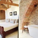 Beams and exposed brickwork create a sophisticated design in this bedroom at Devon Farmhouse