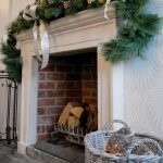 The fireplace in the dining room decorated for a big family get together at Christmas