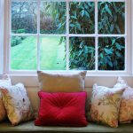 The pretty window seat in the sitting room, with an eclectic mix of cushions