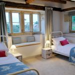 Cotswold Manor has 10 bedrooms for up to 22 guests