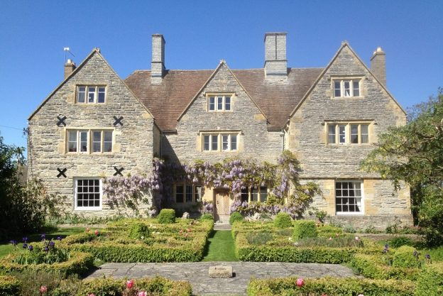 Cotswolds Manor is a honey coloured large manor house with beautiful gardens and lots of original features
