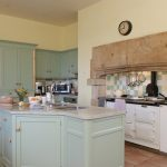 The spacious country style kitchen has a 4 oven Aga and a separate cooker too