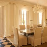 Elegant dining room with floor length doors to the terrace