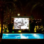 Groups from The Big House Company can enjoy the outdoor cinema screen from the loungers by the pool