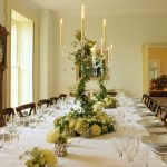 The dining room at Somerset Manor has a large antique table that comfortably seats all your big group.