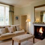 The large sitting room with a roaring log fire and comfortable sofas for relaxing and chatting with friends.