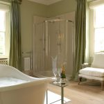 The large en-suite bathroom to Bedroom 1, has a roll top bath and separate shower
