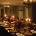 The dining table seats all 24 guests comfortably for celebration candlelit dinners at Widcombe Grange, Somerset