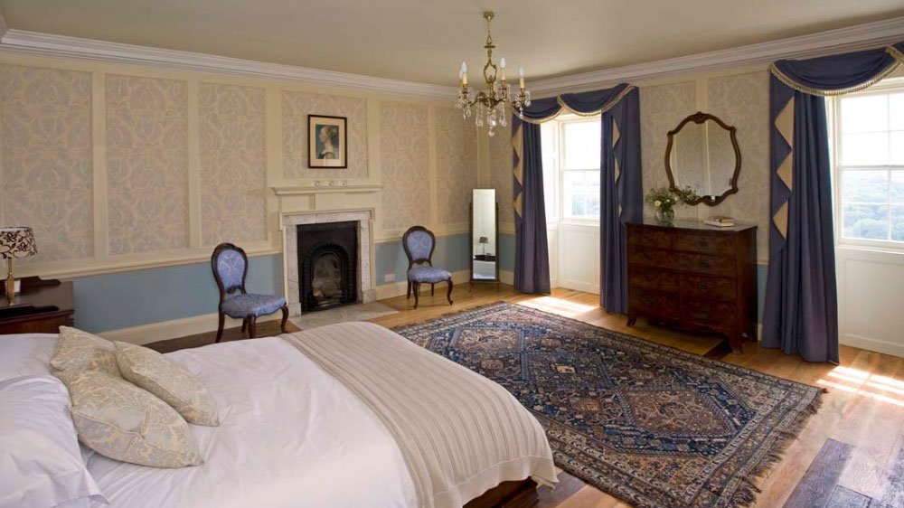 The Wolferstan bedroom is one of ten bedrooms at this large holiday house in North Devon