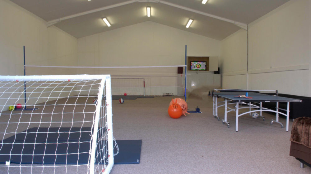 The games barn is a large indoor space for extra fun for your group with a table tennis and 5 a-side football