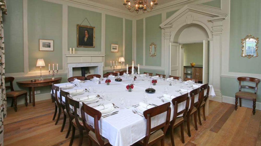 Berry House in Devon has a delightful dining room for friends to enjoy good times together.
