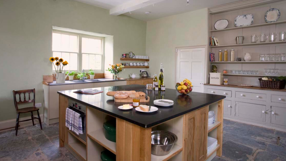The kitchen is spacious for cooking for lots of friends and family, with a central island and handsome large dresser