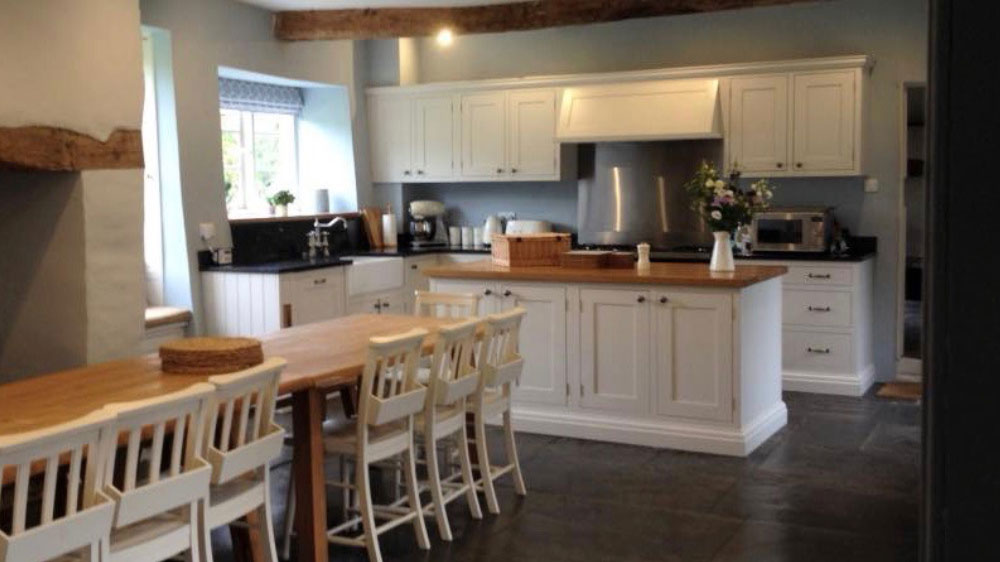 The kitchen is spacious and well equipped for cooking for your big group at Cotswolds Manor.