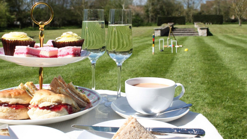 Sumptuous cream teas on the lawn at Cotswold Manor. Contact the Big House Company for recommended local chefs.
