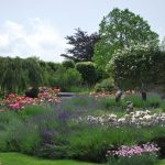 The splendid gardens at this big house to hire have beautiful flower beds and large areas of lawn for children to play.