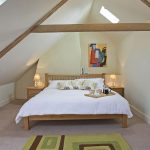 There are 3 spacious bedrooms on the second floor, stylishly decorated with exposed beams.