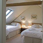 The attic bedrooms at our party house are cosy and quiet.