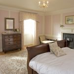 The Buck bedroom has a wooden sleigh bed and lovely antique furniture.