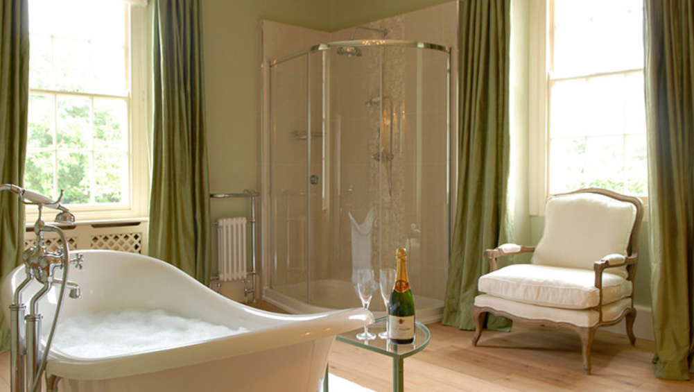 The master bedroom en-suite has a free standing roll top bath and separate shower