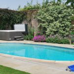 The outdoor heated pool and hot tub at Somerset Manor, available through The Big House Company