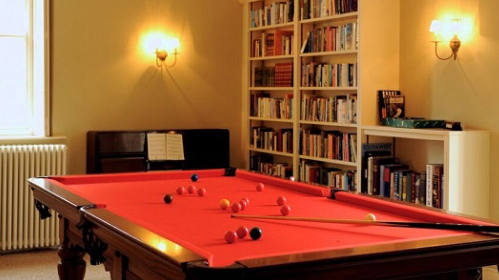 The snooker table is three quarter size, there's a piano and lots of books too.