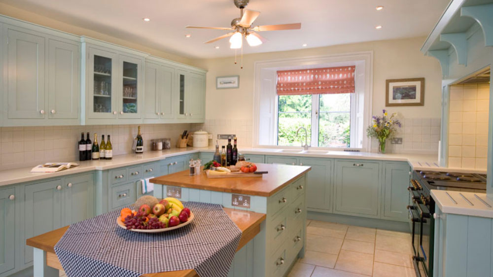The kitchen at this big house has 2 dishwashers, a large range cooker and plenty of equipment for a large group