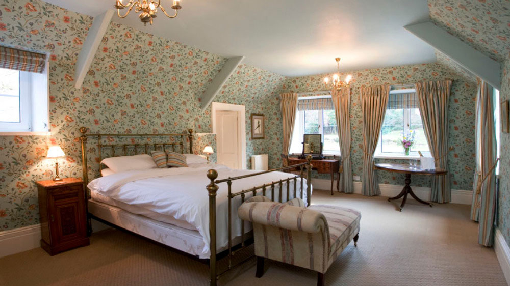 The Kingfisher bedroom is a romantic bridal suite for a country house wedding in Somerset