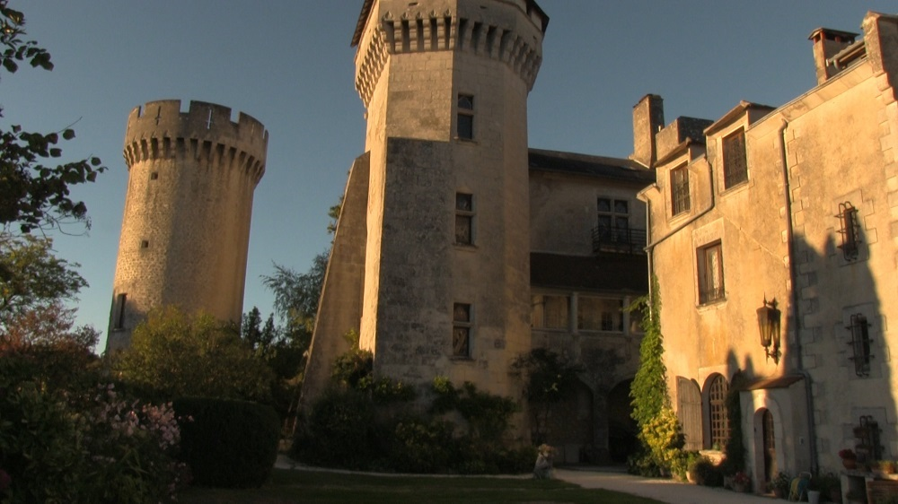 The historic exterior of the French Castle, a private retreat in the Dordogne.